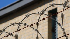 black-metal-wire-fence-near-brown-concrete-building-3993513